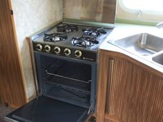 real neat layout in this very tidy Airstream Wall Oven, Airstream, Stove, Safari, Kitchen Appliances, Layout, Diy Kitchen Appliances, Home Appliances, Range