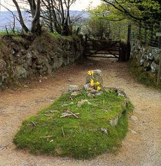 Jay's Grave, Dartmoor Devon. Little is known about the woman buried here, though according to legend she was an 18th century workhouse orphan who was scorned by her lover. After committing suicide she was buried with a stake through her heart. In 1860 she was reburied and in years afterwards flowers would appear, though there were never any prints in the snow on or around the grave. In recent years there have been several reports of a footless apparition that floats around the grave of Kitty Jay