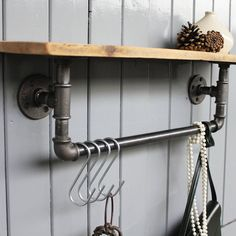 An industrial steel pipe storage bar with shelf.Unexpectedly elegant and versatile, our steel pipe shelf can be used for anything from in the bathroom for towels, in the kitchen for pots and pans, or as a coat rack. Comes ready for use with four butcher's hooks included. Lovingly made to order. Wall fittings not included. Please do contact us as we can custom make any size according to your own specification. You can message us via the 'ask seller a question' button.100% mild steel…