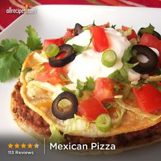 "Mexican Pizza | ""Made this tonight exactly as written and the comments at the table were: Husband: ""This one's a keeper!"" Son #1: ""I'd give this 6 stars!"" Son #2: ""I'd give this 100 stars!"" Easy to make and a great alternative to tacos/burritos for a family who eats Mexican regularly. Thanks for the recipe!"""