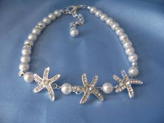 This is a beautiful and fun bridal starfish bracelet for beach and destination weddings. A sparkling crystal rhinestone starfish measuring approximately 1 inches is the focal point of this origin Starfish Bracelet, Bridal Bracelet, Pearl Bracelet, Swarovski Pearls, Crystal Rhinestone, Wedding Planning Timeline, Cute Wedding Ideas, Garter Set, Destination Weddings