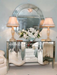 Interior decorating in pale tones with mirror for glamour
