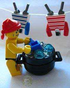 Cleaning legos in the dishwasher (top rack, no heat dry, low heat setting) - great idea!