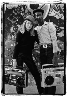 Photo of Tina Weymouth and Grand Master Flash by Laura Levine, 1981.    This photo was taken just after Weymouth started her Talking Heads side project Tom Tom Club with her husband Chris Frantz. Their track Genius of Love had just been sampled by Grandmaster Flash on It's Nasty (and then again in the 90s by Mariah Carey). According to the photographer this photo was the first meeting of Tina and Grandmaster Flash. —via The Strut.
