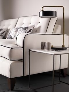 White Monaco Sofa from Delcor with black piping and buttons