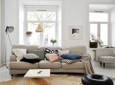 Övre Majorsgatan 10 B | Stadshem - Scandinavian Design, White Interior with Earth Tones. Sequin Pillow, Cow Hide Rug, Throw Pillows.