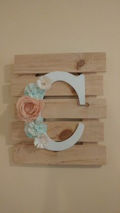 C monogram made with Sola Wood Flowers. Love the country look. Www.facebook.com/mixandmatchcakes
