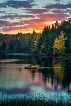 Michigan Morning - The sun rises over a sleepy Michigan lake with swimming platform.