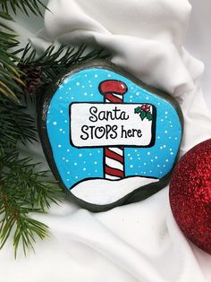 Santa Stops Here Painted Stone with Peppermint Sign, North Pole Santa Stop Rock, Christmas Rock for Kids, Holiday and Christmas Collectible Christmas Rock, Christmas Mantels, Christmas Wreaths, Christmas Ornaments, Pebble Painting, Pebble Art, Stone Painting, Stone Crafts, Rock Crafts