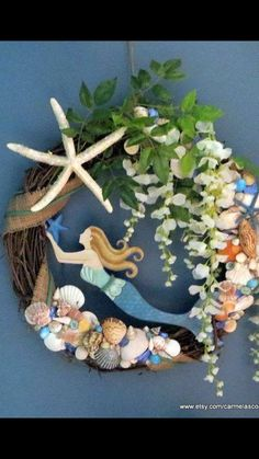 Here is a large mermaid wreath, a 24 inch mermaid wreath with starfish and seashells along with pretty florals and greenery. I glitzed up Coastal Wreath, Nautical Wreath, Beach Wreaths, Seashell Art, Seashell Crafts, Starfish, Seashell Wreath, Wreath Crafts, Diy Wreath