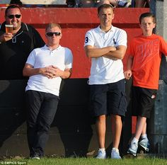 Paul Scholes and Phil Neville watch on as their team Salford City take on Stalybridge Celtic
