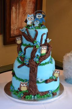Blue Owl Baby Shower Cake - This is a 4 tier fondant covered cake with an owl theme for a baby shower.  Enjoy!