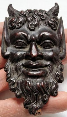 Antique carved wood Pan face mask