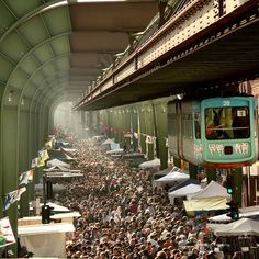The monorail in Wuppertal, Germany, is called SCHWEBEBAHN, down on the street: a fleamarket