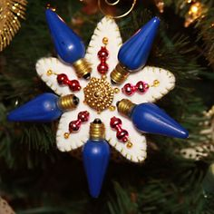 sparkling christmas light star ornaments made with old christmas light bulbs