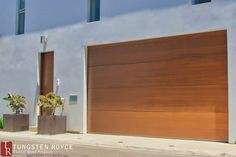Give your home a unique feel with contemporary or modern garage doors. Custom-built garage doors from Tungsten Royce, schedule a free appointment today! Contemporary Garage Doors, Modern Entry Door, Modern Garage Doors, Garage Door Styles, Wood Garage Doors, Garage Door Design, Entry Doors, Royce, Larry
