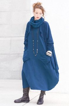 Cloud Dress in Minuit Tokyo. A very modern, oversized dress that has a balloon-shaped skirt, V-neck, long sleeves, and outside angled pockets. Made of cotton