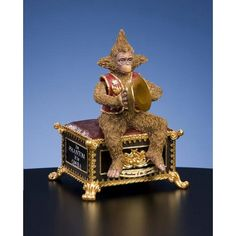"""Music Box Phantom of the Opera Phantom Monkey Figurine features intricate detail and moving cymbals that highlight this wonderful rendering of the monkey from Phantom.     Tune: Masquerade"""""""