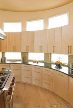 #Kitchen Idea of the Day: Modern semi-circle kitchen (By Crown Point Cabinetry) with backsplash windows.