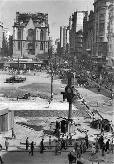 1952 - Sé square under renovation during the construction of the new cathedral (at the background)