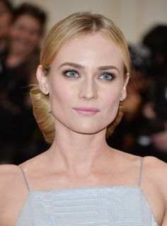 Pin for Later: Endless Gorgeous Celebrity Wedding Hair Ideas Wedding Hairstyles: Updos Diane Kruger pulled her hair back into an elegant chignon on the 2014 Met Gala red carpet.