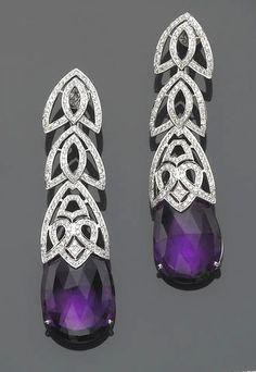 An amethyst, diamond and eighteen karat white gold earrings