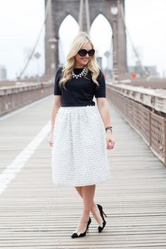 Jessica Sturdy looking lovely in a bow-covered white midi.