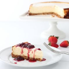 The BEST classic cheesecake recipe - incredibly creamy, topped with a strawberry pinot reduction