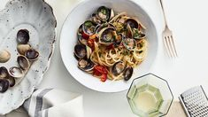 Tiny clams like cockles taste sweet and make an excellent foil for tangy cherry tomatoes and Martha's DIY roasted-garlic butter in her take on the Italian classic. Spaghetti Vongole, Martha Stewart Recipes, Seafood Pasta Recipes, Fusilli, Roasted Garlic, Ravioli, Pasta Dishes, Pasta Sauces, Fish And Seafood