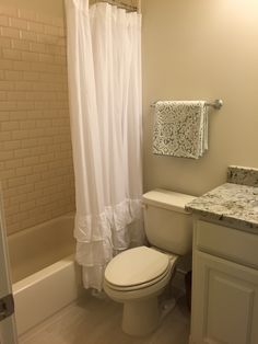 **(Guest Bath Upstairs)- Granite, Beveled Subway Tile, Pottery Barn: Shower Curtain, Towels. Still need to hang the mirror, and am waiting on the mason jar soap dispenser from an Etsy seller.