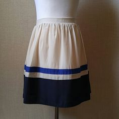 """Willow & Clay color block skirt Like new. Rear zip. Cream, royal blue, and navy blue.   14"""" waist measurement 16"""" length  Lined. Polyester with a silk feel to it. Willow & Clay Skirts"""