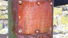 This is the plaque memorializing one of the lights along Clovelly harbor....