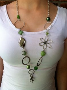 Green and Silver Lanyard Necklace on Etsy, $15.00 Or any other pretty jewelry-like lanyard.  Clear/White/silver would work best for me in terms of coordinating with outfits