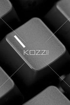 black keyboard - key i - Closeup of a black computer keyboard with the I key emphasized.