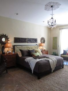 Chandelier and Wood Carvings above bed - nice textures but there seems to be something missing in this room - needs some Wendy O. to fix it