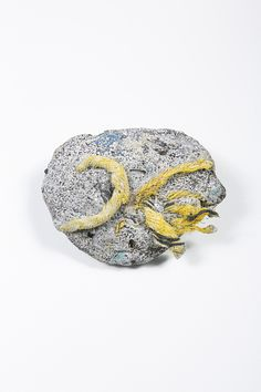 """Kelly Jazvac, """"Plastiglomerate Samples,"""" 2013, plastic and beach sediment, including sand, basalt rock, wood and coral. All of these found object artworks are the results of a collaboration between Jazvac, geologist Patricia Corcoran and oceanographer Charles Moore. All photos are credited to Jeff Elstone."""