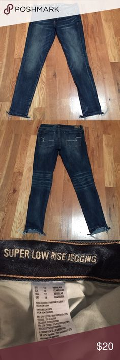 American Eagle Super Low Rise Jegging 12R Like new condition. The distressing at the bottom is manufactured (bought them like that). Super comfy. Size 12R American Eagle Outfitters Jeans Skinny