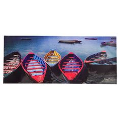 Showcasing a boat motif in red, blue, and yellow, this lovely canvas print is a perfect addition to your living room or sunroom.  Pr...