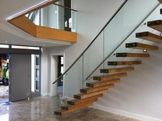 Beautiful entrance staircase at a private residence very elegant and modern look.