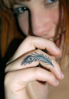 I <3 tiny tattoos.  And peacock feathers.