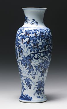 A RARE AND UNUSUAL UNDERGLAZE-BLUE AND COPPER-RED 'SQUIRREL AND GRAPEVINE' VASE QING DYNASTY, KANGXI PERIOD