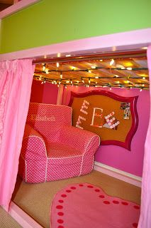 Set up under ikea kura bed with lights and reading nook. Website has a few examples