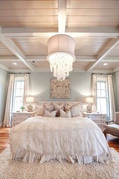 Cottage Master Bedroom with Pair of vintage nightstands, Hardwood floors, Box ceiling, Crown molding, Chandelier