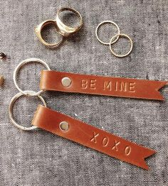 Made from leather strips, these leather keychains secure keys with your name, an inside joke or a silly phrase.