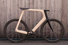 Arvak is a minimalist wooden bike designed by Paul Guerin and Till Breitfuss of Keim. The lines of the frame certainly look nice and sleek, but if the seat. Wooden Bicycle, Wood Bike, New Bicycle, Bicycle Rack, France Sport, Vintage Cycles, Motorized Bicycle, Bike Reviews, Bike Style