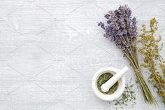 Lavender, healing herbs and mortar Photos Bunch of lavender, healing herbs and mortar on gray wooden board. Top view, flat la by chamillewhite Healing Herbs, Natural Healing, Drinking Hot Water, Pastel Background, Herbal Medicine, Herbalism, Lavender, Creative, Top View