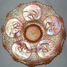 """FENTON Carnival Glass DARK MARIGOLD HORSEHEAD MEDALLION (Pharaoh's Horses) with Berry & Leaf Circles back patter Plate. This example has an excellent mold strike and rich, colorful iridescent Dark Marigold finish. Measures 7 1/2"""" X 1 1/4""""."""