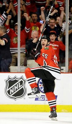 ... Chicago Blackhawks center Andrew Shaw celebrates after scoring the  winning goal during the third overtime period of Game 1 in their NHL  Stanley Cup ... 2e80eb241