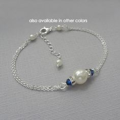 Navy Bracelet, Swarovski Ivory Pearl and Dark Sapphire (Dark Blue, Navy Blue) Crystal Bridesmaid Bracelet AVAILABLE IN OTHER COLORS: Please see color chart for options and kindly note on check-out your preferences.  Bracelet default length: 6.5 inches with 1.5-inch extender. For other lengths, please select from drop down list.  BRACELET SIZING GUIDE: To determine appropriate size, take measurement around the wrist bone and add half an inch.  PERSONALIZE YOUR JEWELRY - ADD AN INITIAL CHARM…