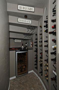 Traditional Wine Cellar with Built-in bookshelf, slate tile floors, High ceiling, flush light
